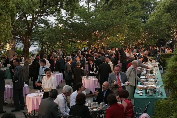 A party in front of the statue of Tamaki Miura in Glover Garden